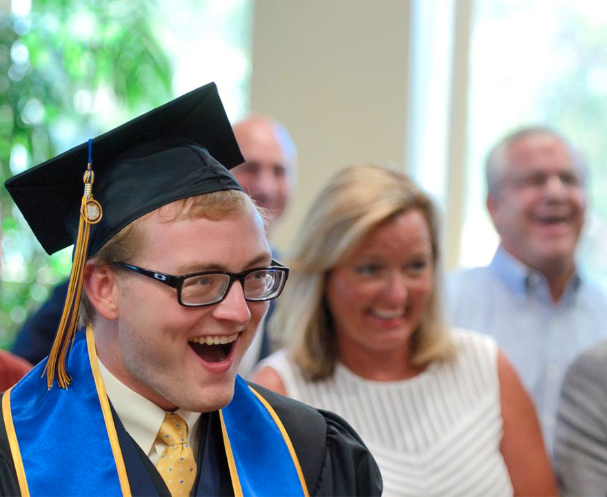 Mini commencement re-created for scholar-athlete who missed June ceremony for eyesight-saving surgery