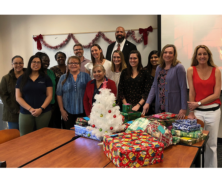 UCI soc sci staff gather to wrap donated gifts for UCI's Staff Helping Hands Program