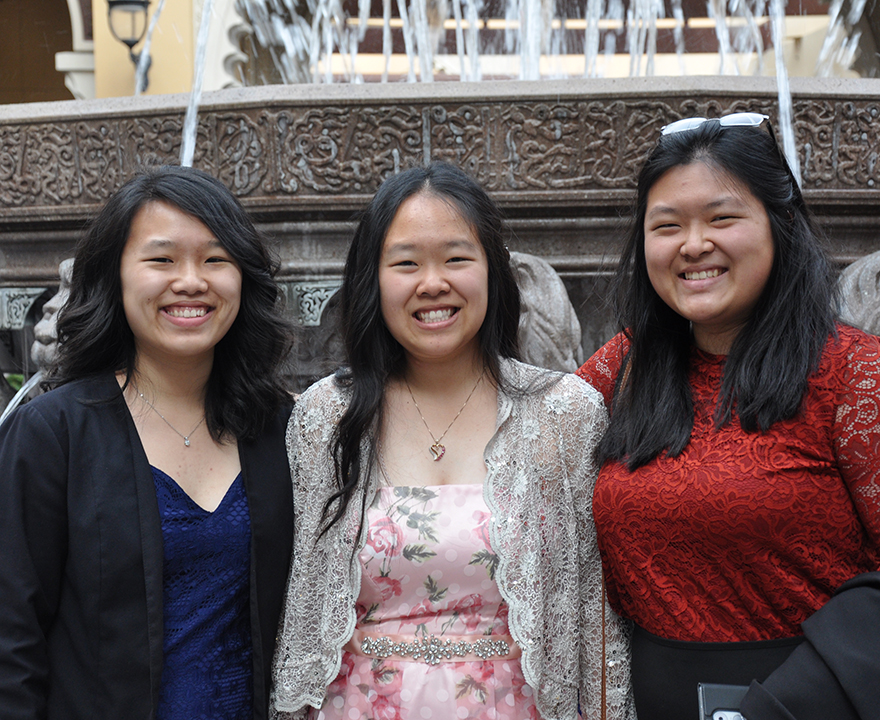 with sisters from left to right: Amy, Mary, and Wendy Hu