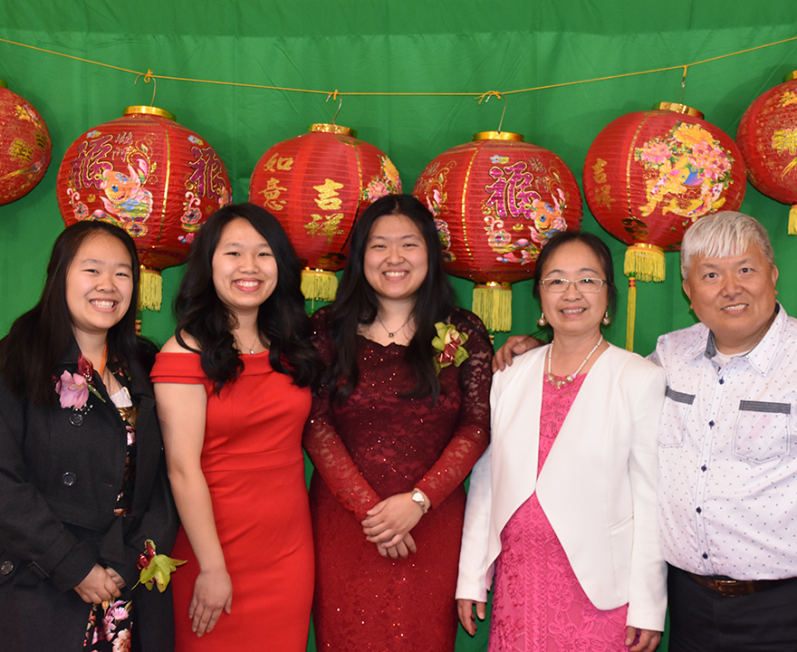 With family from left to right: Mary, Amy, Wendy, Alice, and Joe Hu