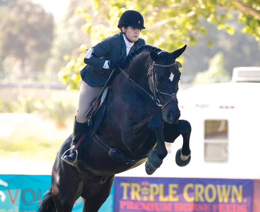 Melanie Henderson, UCI business economics '10 and MBA '17, is a competitive amateur equestrian in her off time from Taco Bell headquarters in Irvine