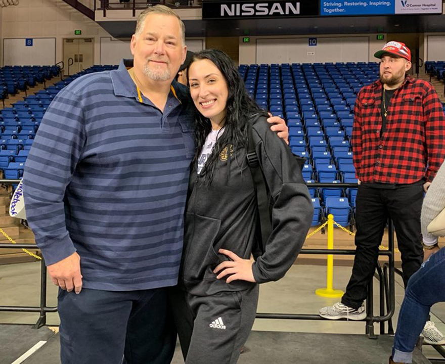 Sabrina Engelstad, sociology and education major and starting center for the women's basketball team, is following in her dad's footsteps