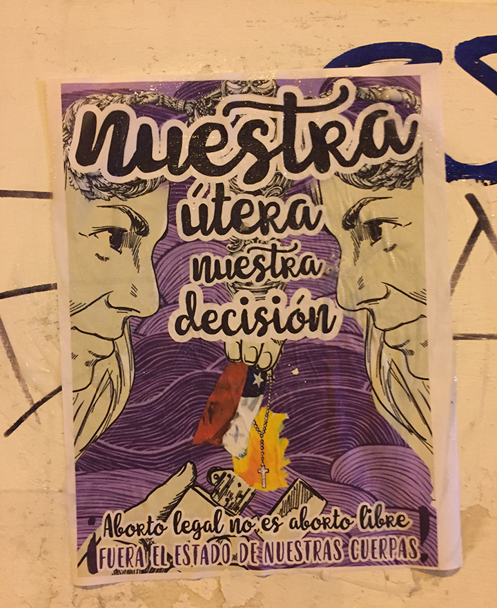 """Artwork that promoted """"nuestra útera, nuestra decisión"""" (""""our womb, our decision"""") was glued to the walls of businesses during an abortion rights march in Valparaíso."""