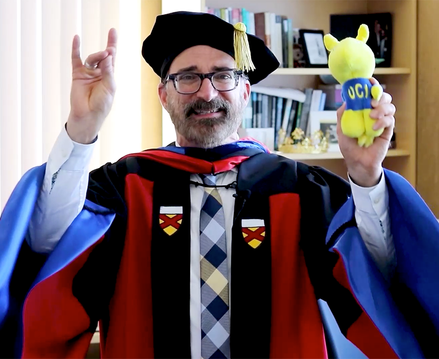 bill maurer in cap and gown with peter the anteater