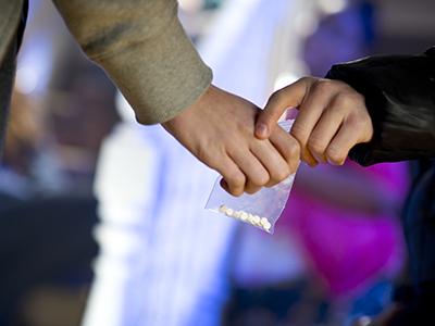 Hands exchanging pills